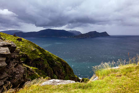 View from the bird cliffs on the ocean in windy weather in Norway