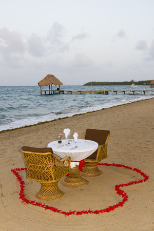Romantic dinner setup for two on the beach in Belize