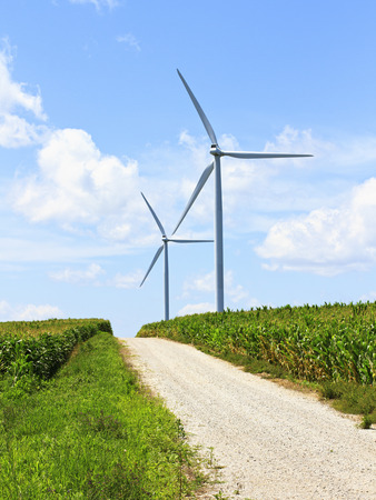 Wind turbines provide energy in a rural area on a dirt road