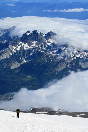 Lone mountaineer climbing Mount Rainier in Washington, USA