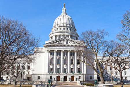 State capitol building in Madison, Wisconsin USA on a bright winter day with blue sky