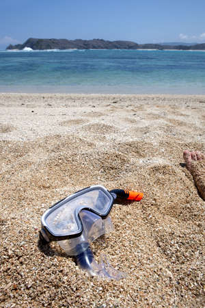 Diving goggles on a beach Stock Photo