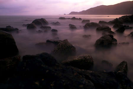 Mystic rocks in the ocean Stock Photo