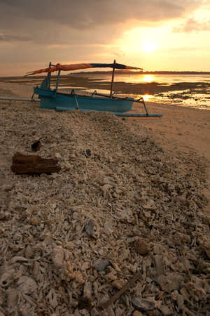 Boat on a tropical beach during the sunset. ( Island Gili Air, Indonesia)