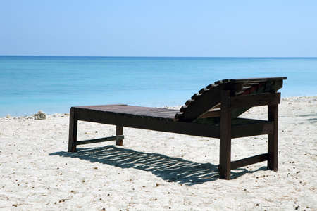 Canvas Chair on tropical beach photo