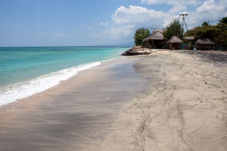 Bungalows on a tropical beach ( Gili Air ) Stock Photo