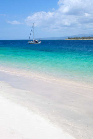 Boat close to a beach on a tropical island Stock Photo