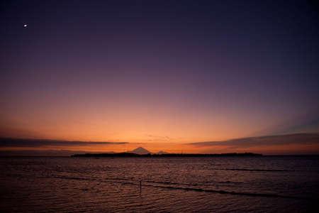 Beautiful sunset behind a island