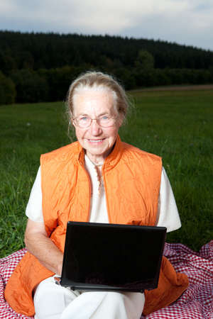Old woman with laptop