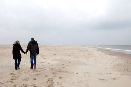 Couple is walking on the beach Stock Photo - 7262214