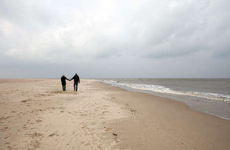 Couple is walking on the beach photo