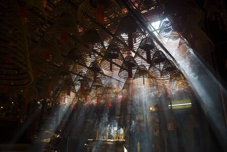 crepuscular: Incense and crepuscular rays in Hong Kong Man mo temple.