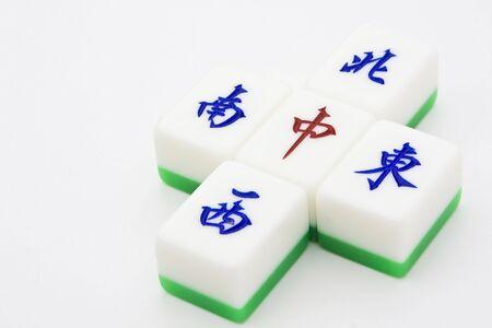 mahjong: Chinese game similar to poker. Very popular gambling game.