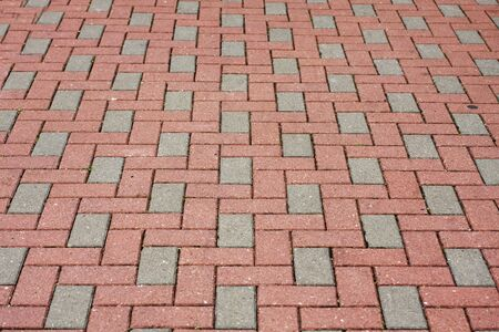 it is a Brick pavement in a city   photo