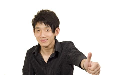 Young Asian man making good Stock Photo - 7299385