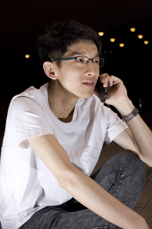 Asia young man talking phone Stock Photo - 7299386