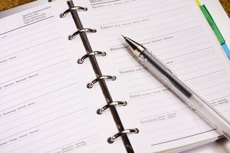 appointment book: pen on schedule book Stock Photo
