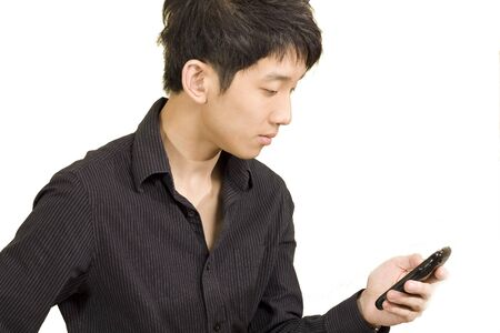 casual asian businessman texting on his cell phone  photo