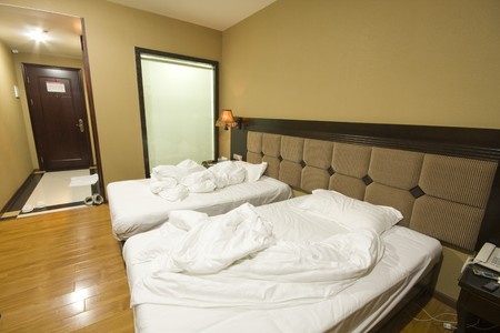 Double bed in the hotel room Stock Photo - 7454508