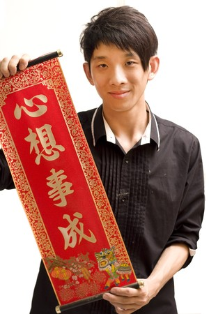 Young Asian man holding chinese lucky word for chinese new year photo