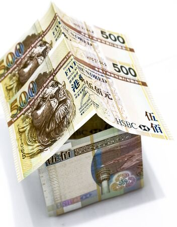 Money house made from hong kong dollars photo