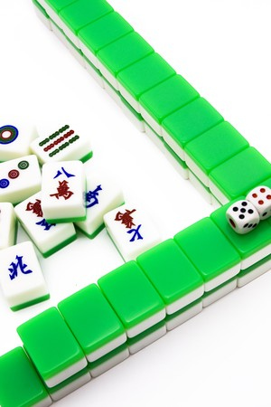 Mahjong tiles aligned and two dices  photo