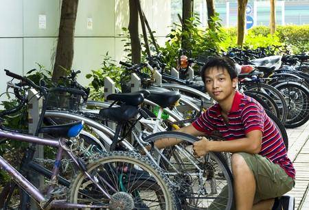 asia boy fix his bike photo