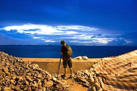Photogrpher working at sunrise Stock Photo - 7600960