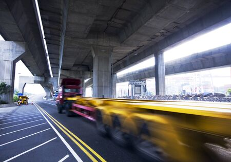container car fast moving under the freeway bridge photo