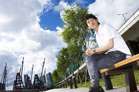 asia man relax in the park in the city photo