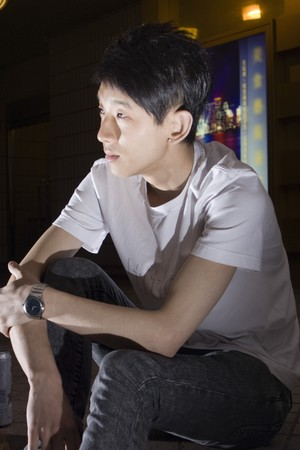 Asia young man thinking photo