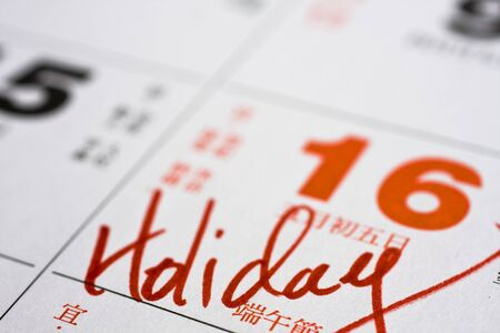 important date: Hand writing holiday important date on calendar