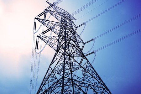 pylons: Electricity pylons with long cable at day Stock Photo