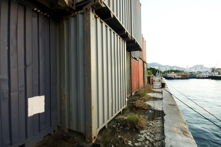 Shipping containers near the sea in hong kong at day photo