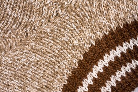plain stitch: Stockinette of yellow melange mohair yarn as background.