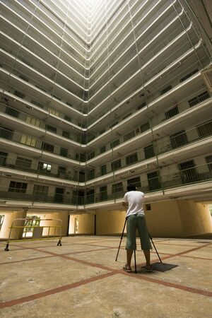 man take photo of Hong Kong public housing apartment block  photo