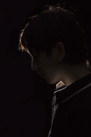 contrast: Portrait of an Asian man in the darkness for texture