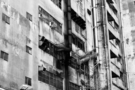 industry building outside in black and white photo