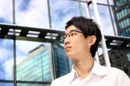 asian young, handsome business man at the office building . Stock Photo - 8179315