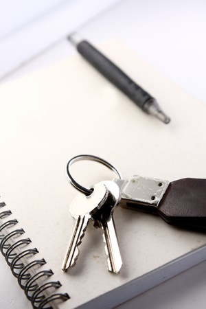 Diary, the handle and keys on a white background . photo
