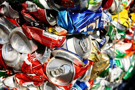 Compressed beer can background close up photo