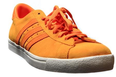 sport shoe: Orange sport shoe close up, isolated on white
