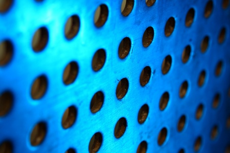 metal background with circles with blue toned photo