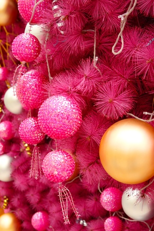 pink christmas background with many balls photo