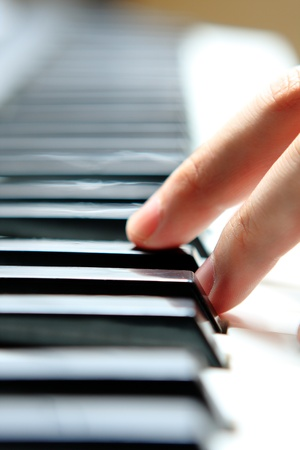 Close up of the hands of a young man playing piano  photo