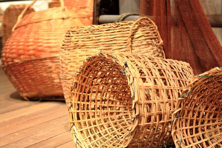 many yellow Wicker Basket  on the floor photo