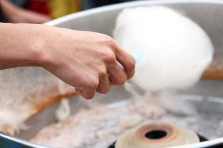 close up of man making cotton candy  photo