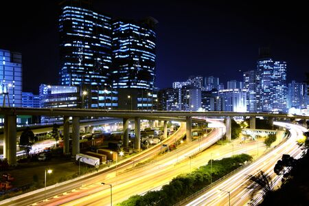 Modern Urban City with Freeway Traffic at Night, hong kong  photo
