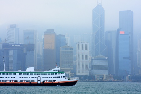 hong kong in mist and ferry in habour Stock Photo - 8936888