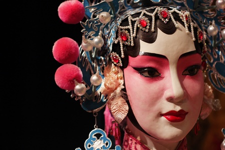 chinese opera: chinese opera dummy and black cloth as text space , it is a toy, no need model release. Stock Photo